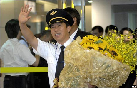 China Southern Airlines Chairman Liu Shaoyong waves as he arrives in Taoyuan airport in Taiwan