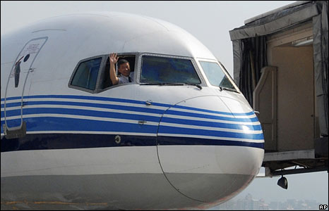 The pilot of a plane arriving from Xiamen waves after he lands in Taiwan