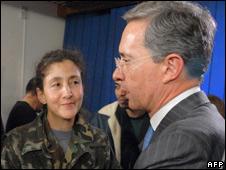 Colombian President Alvaro Uribe greets Ingrid Betancourt at Narino palace in Bogota
