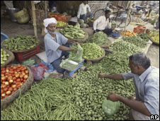 Vendors sell vegetables at a market in Allahabad, India