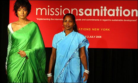 Scavenger from India (wearing a light blue sari) at a UN fashion show