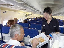 Air hostess serving food to Air France passenger