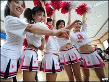 Cheerleaders strike a pose during a training session for cheer squads on July 4