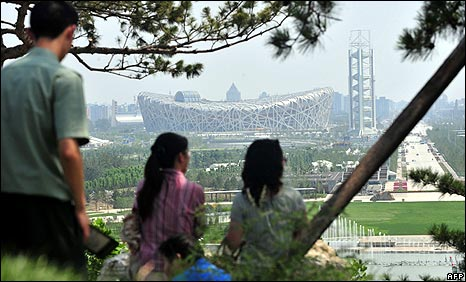 Visitors to the Olympic Forest Park take in a view from north looking south toward the National Stadium in Beijing on 3 July
