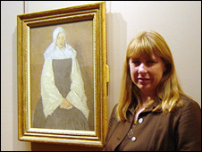 BarberInstitute Director Ann Sumner next to one of the Mere Poussepin portraits