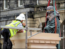 Satue of Adam Smith being erected