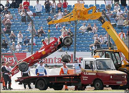 Massa's car is lifted off the track after crashing