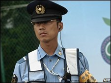 A security official outside the venue of the G8 Summit in Rusutu (5/7/2008)