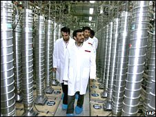 Iranian President Mahmoud Ahmadinejad, centre, visits the Natanz uranium enrichment facility on 8 April 2008