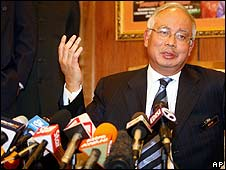 Deputy Prime Minister Najib Razak speaks to reporters on Thursday