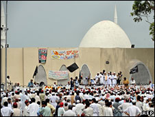 Pakistani religious students and residents gather outside the Red Mosque after Friday prayers, 4 July