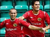 Emir Bajrami (left) celebrates scoring the opening goal at Easter Road