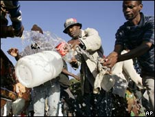 Collecting water near Johannesburg, South Africa. File pic