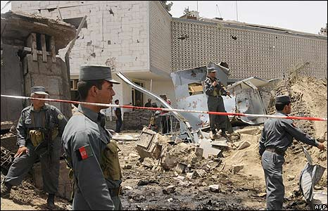 Afghan police at the site of a suicide bomb attack in Kabul