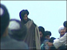 Mullah Omar, pictured with other Taliban in northern Afghanistan