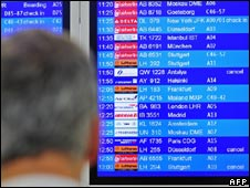 Passenger looks at a departures board in Berlin