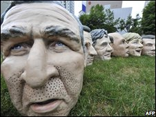 Masks of G8 leaders used by activists in protests