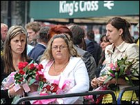 Crowds pay their respects at King's Cross station