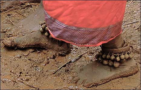 Witchdoctor's mudcaked feet