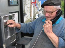 Cadwgan Edwards in the phone box near his home