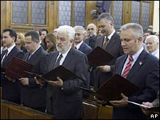 Mirko Cvetkovic (third left) and his ministers are sworn in Belgrade on 7 July 2007