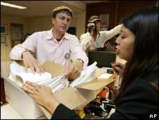Brian McConnell hands in his petition at San Francisco City Hall