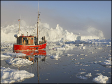 Trawler passing Arctic icebergs