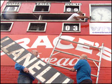 Workmen dismantle the Stradey Park scoreboard