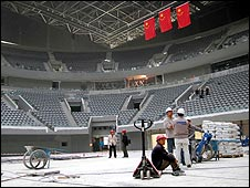 Unfinished venue in Beijing, with Chinese flags flying