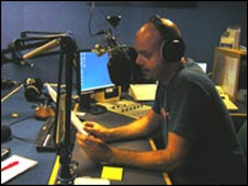 Newsreader Dom reads Iain's script