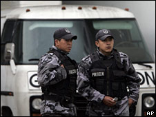 Police stand guard  outside Gamavisoin in Quito