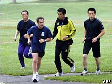 French President Nicolas Sarkozy jogging in Toyako, Japan