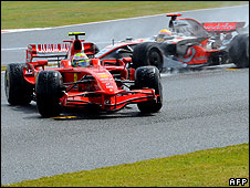Felipe Massa spins his Ferrari as Lewis Hamilton passes on his way to victory