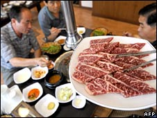 South Koreans taste US beef during a tasting event supported by the Korean Medical Association at a restaurant in Seoul on Wednesday
