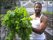 Showing off prize greens from a Detroit urban farm