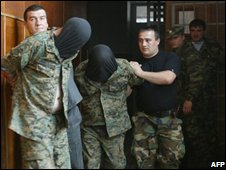 Separatist authorities in the Georgian breakaway region of South Ossetia escort arrested Georgian soldiers, 08/07/08