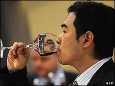 Man drinking wine at wine expo in Hong Kong
