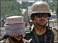 A paramilitary soldier detains a Lashkar-e-Islam suspect