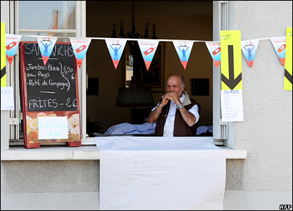 A shopkeeper in Aigurande on day six of the Tour de France