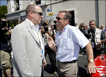 Prince Albert II of Monaco talks to former Tour winner Bernard Hinault