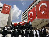 A funeral ceremony is held for Turkish police officers killed in an attack  on the US consulate, Istanbul, 10 July