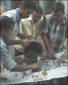 Bank staff in Calcutta count Laxmis Das' coins