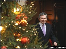 Gordon Brown behind a Christmas tree