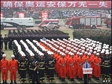 Chinese police parade during an anti-terrorism drill for the 2008 Beijing Olympic Games in Xian, Shaanxi province, on 11 June