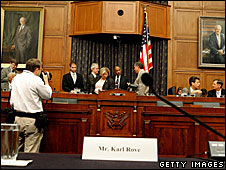 A name-tag marking Karl Rove's empty seat at the congressional hearing
