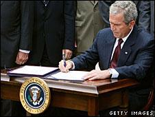 George W Bush signs into law the bill granting telephone companies immunity