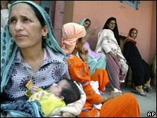 Kashmiri women wait outside the only maternity hospital in Srinagar, India, 10 July 2008