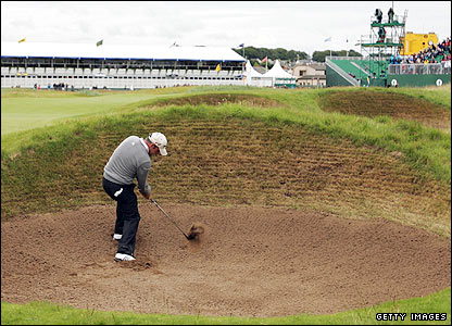 Paul McGinley gets out of a bunker on the 16th