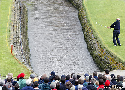Padraig Harrington tries to get out of trouble at the last