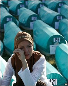 Bosnian Muslim woman weeps among coffins of Srebrenica victims, 11/07/08